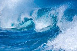 Powerful waves curl at shorebreak