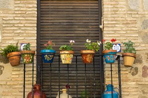 Balcony with painted flower pots