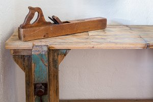 Old wooden plane on bench