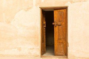 Solid wooden door in plaster wall