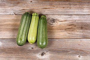 Whole Cucumbers on Vintage Wood
