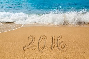 Sand writing on beach for 2016