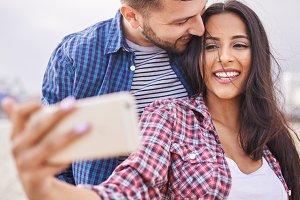 playful romantic couple selfie