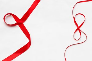 Red tape on a white background.
