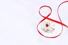 Mockup. Ring, red ribbon.