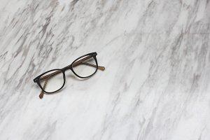 Eyeglasses on marble background