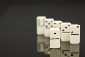 Leadership concept using dominoes