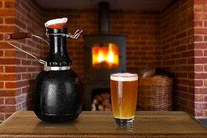 Growler and glass of cold beer