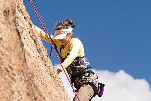 Senior adult woman climbing