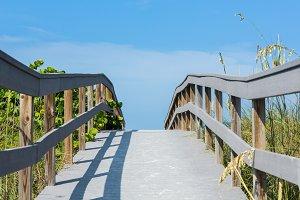 Walkway to beach on sunny day
