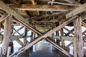Wooden structure underneath pier