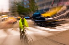 Cyclist riding in busy traffic
