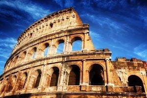 Colosseum against deep, blue sky.