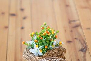Vase of flowers in a brown bag.
