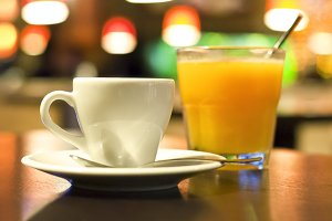 Cup of coffee and a glass of orange