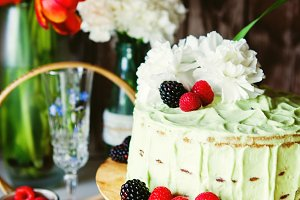 Cake with berries and carnation