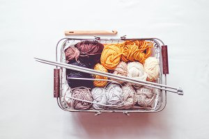 Colored wool balls in a basket
