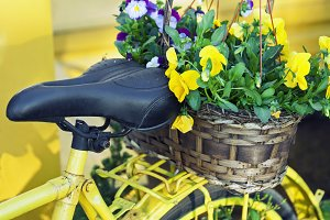 Yellow bicycle with flowers