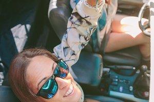 Happy women having fun inside of car