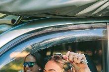 Happy woman showing car keys