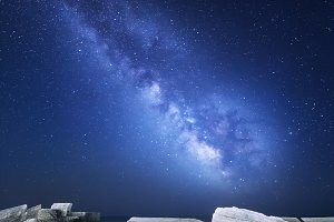 Milky Way at the sea with breakwater