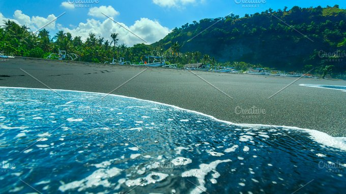 Boats on the beach of black sand on the island of Bali in Indonesia in sunny summer day.jpg - Nature