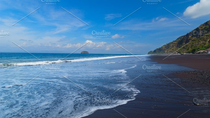 The beach with black volcanic sand on the island of Bali in Indonesia on a sunny summer day..jpg - Nature