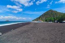 Beach of black sand on the island of Bali in Indonesia.jpg