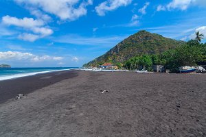 Beach of black sand on the island of Bali in Indonesia.jpg
