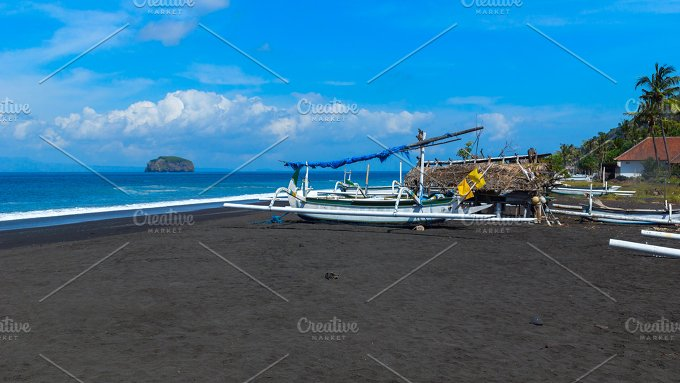 Junks on the beach of black sand on the island of Bali in Indonesia.jpg - Nature