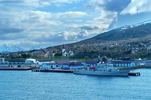 Mountain landscape of water bay with grey warship.jpg