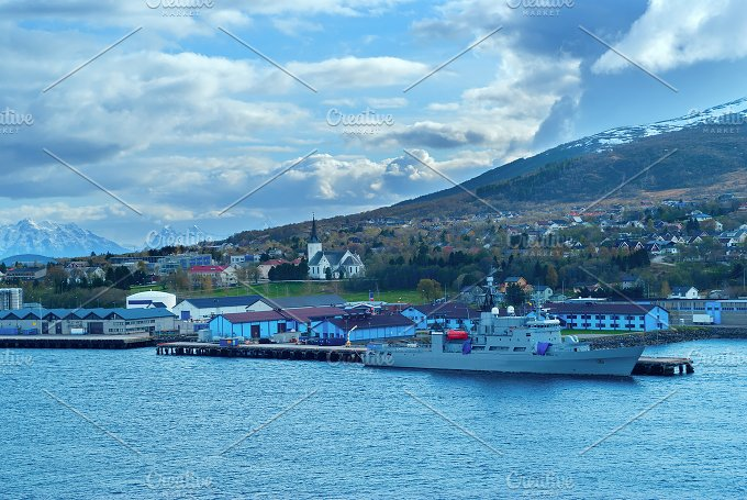 Mountain landscape of water bay with grey warship.jpg - Photos