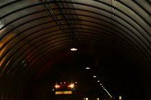 Truck in a long dark road tunnel.jpg