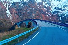 Grey bridge on Norwegian road in the mountains.jpg