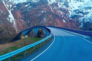 Grey bridge on Norwegian road in the mountains.jpg