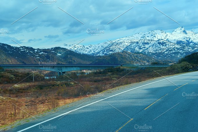 Bridge on the Norwegian grey road in the mountains.jpg - Photos