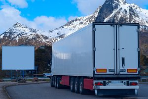 White refrigerated truck and big white billboard.jpg