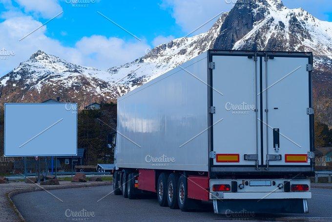White refrigerated truck and big white billboard.jpg - Transportation