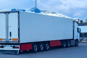 White refrigerated truck on background of the mountains.jpg