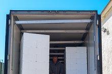 Worker loads white semi-truck.jpg