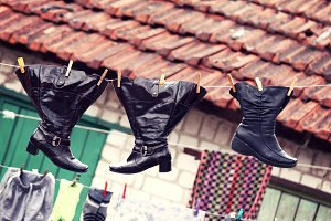 Wet shoes hanging on clothesline