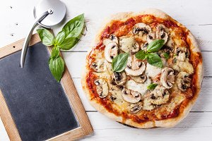 Pizza with mushrooms and basil
