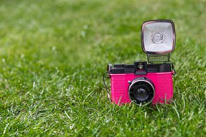 Retro pink camera and flash