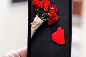 Hand holding smartphone with image o