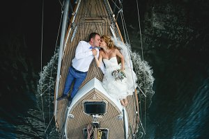 Kissing newlyweds on the boat