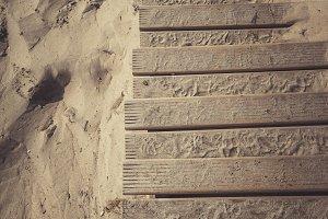 Feet, wood and sand