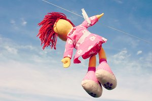 Doll hanging on clothesline