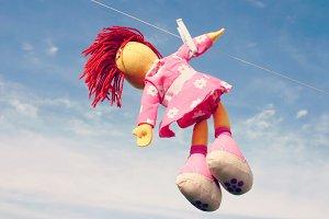 Doll hanging on clothesline