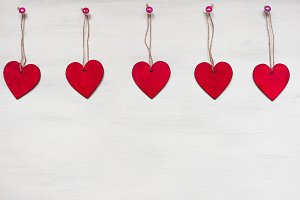 Wooden hearts on white background.