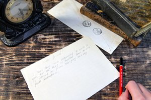 Woman hand write letter on vintage
